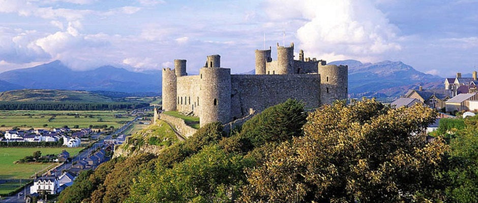 Harlech Castle and Town with Snowdonia in the background