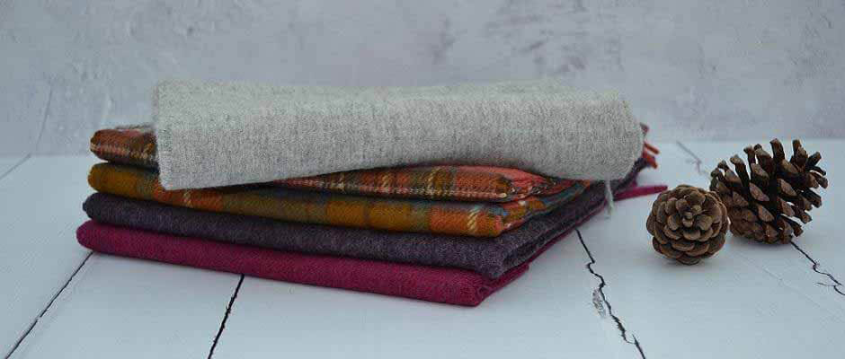 Merino Lambswool Scarves -  Soft and warm Merino Lambswool scarves, available in fashionable checks, plains and classic tartan styles. Beautiful 100% Merino Lambswool tartan style scarves are perfect accessories for both men and women