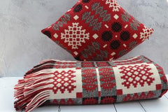 Welsh tapestry blankets and cushions - Nothing says hiraeth more than an iconic red Welsh tapestry blanket