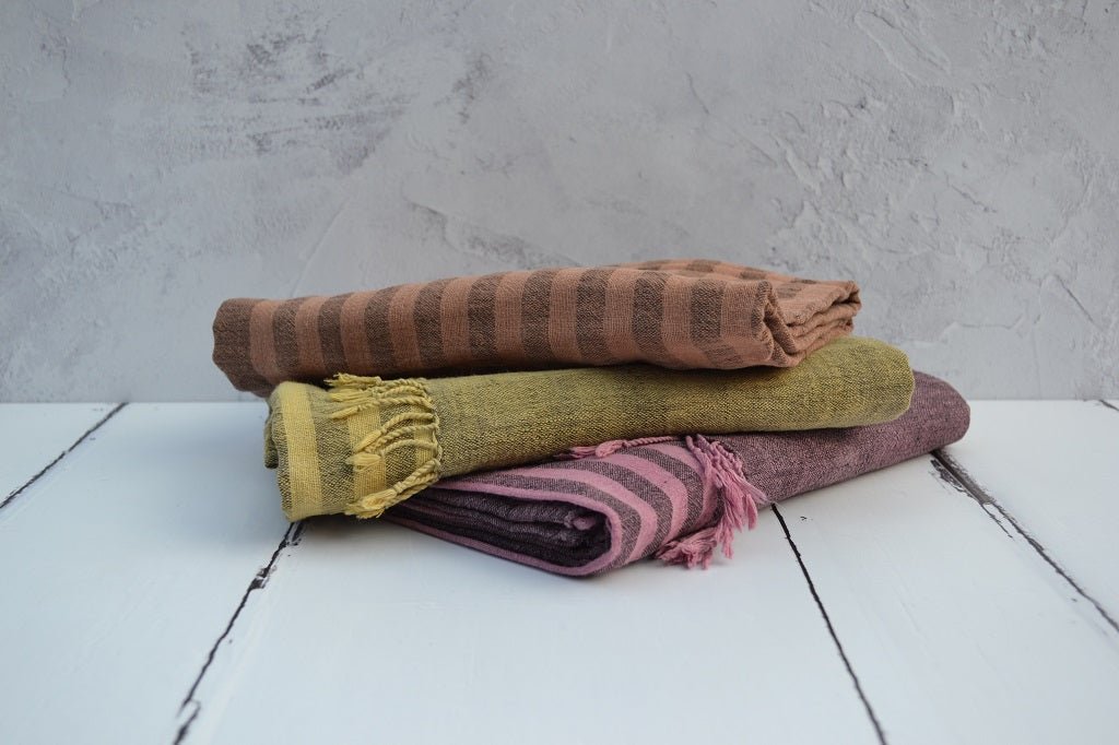 Handwoven organic cotton scarves. Hand dyed with natural dyes using Cutch, Logwood, Madder/Cochineal and Osage