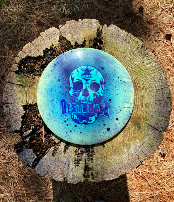 Star Destroyer disc golf disc spray dye with skull stencil