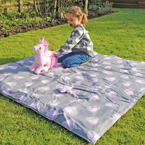 Our beautiful Emmie enjoying her Minene activity blanket