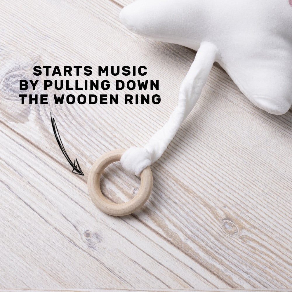 White Star Shape music toy with Wooden Ring Pull.  Plays Brahms Lullaby for 1min15sec