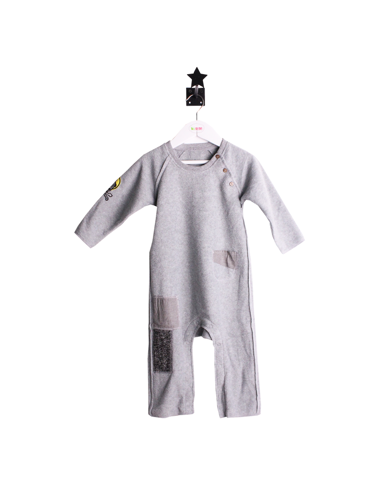 light grey romper with patches and skul on sleeve