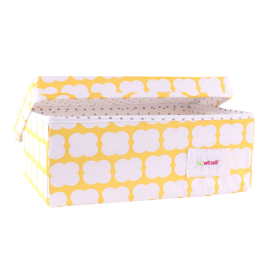small storage box- Yellow with white clouds and white and grey polka dot lining.