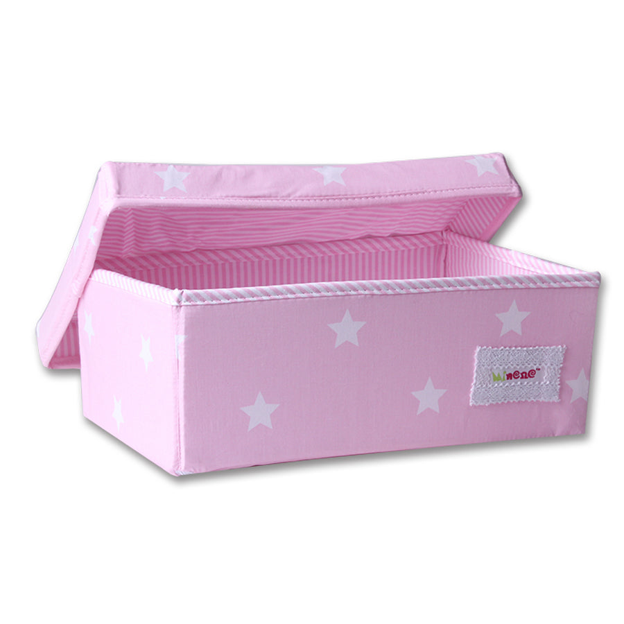 Small storage box in baby pink with small white stars and pink and white lining