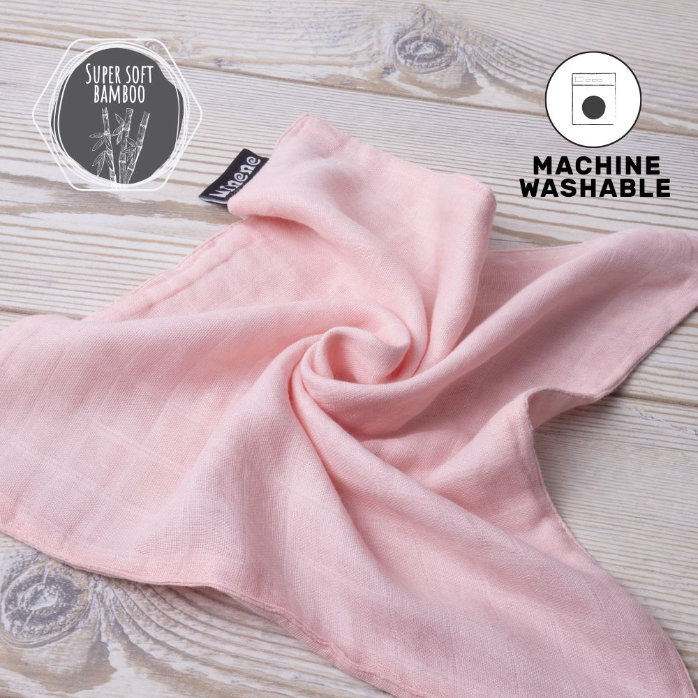 Pink Bamboo Muslin Cloth with White Textured Silicone Teething Ring.