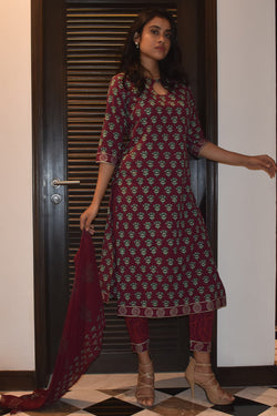 Posing in maroon cotton suit set online