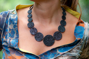 sustainable black necklace with recycled materials and banana fibre