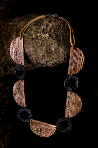 necklace made of recycled materials and natural fibre