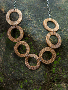 sustainable rings necklace with recycled materials and banana fibre