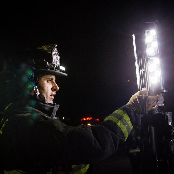 FoxFury Nomad® Transformer® Scene Light - Cordless and weatherproof light extends up to 12 feet (3.7 m) tall. Firefighter adjusts light head