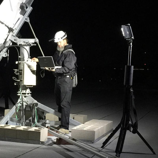 FoxFury Nomad® 360 Scene Light - cordless, rugged area light delivers up to 8,000 lumens and extends over 8 feet tall. Shown with satellite worker