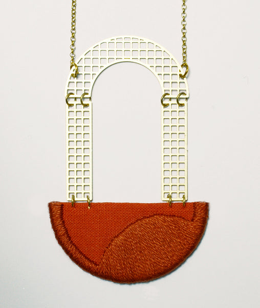 Folly - Burnt Orange Arch embroidered pendant on white