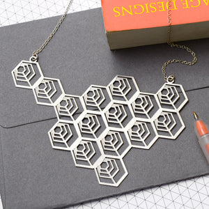 'Apis' large etched geometric honeycomb necklace.
