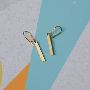 Line earrings brass