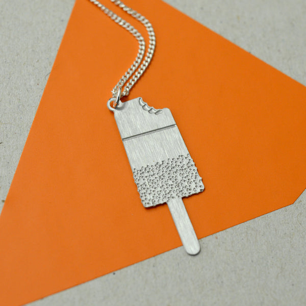 Lacy Necklace on orange background