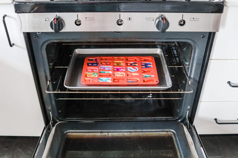 Crayon Letters melting in an oven at 230 degrees