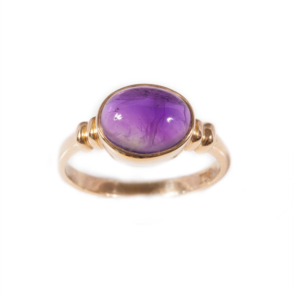 Cabachon amethyst ring set in 9ct yellow gold