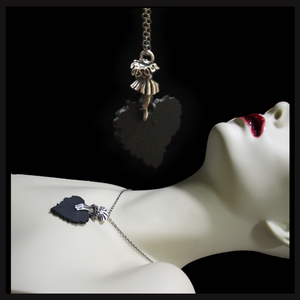 Tattered Heart in Hand necklace (silver) - Laura Flook