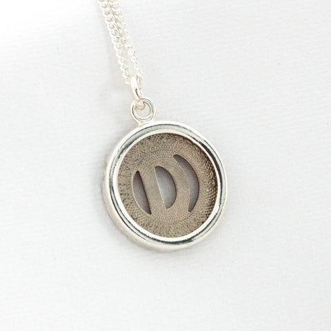 Dallas Token Sterling Silver Pendant