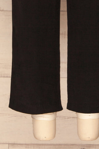Aase Black V Neck Straight Leg Jumpsuit | La petite garçonne bottom close-up