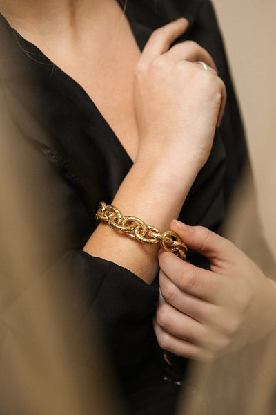 Aiptasia Oversized Golden Chain Bracelet | La Petite Garçonne on model