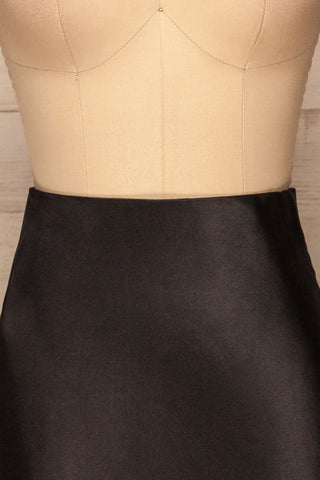 Alia Noir Black Midi Satin Skirt | Jupe front close up | La Petite Garçonne
