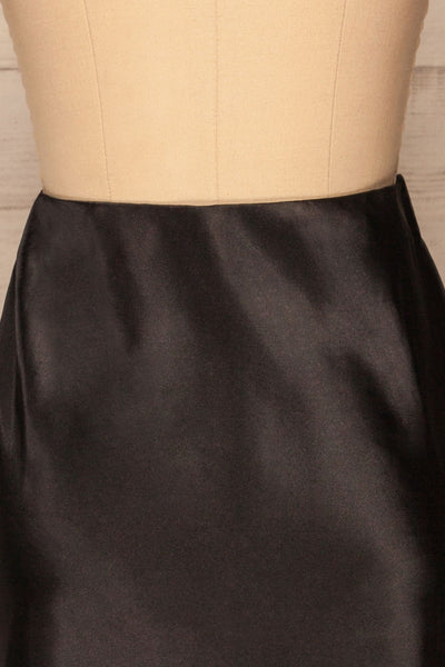 Alia Noir Black Midi Satin Skirt | Jupe back close up | La Petite Garçonne