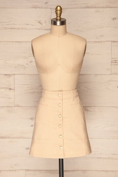 Alijo Beige Button-Up Mini Skirt with Pockets | La Petite Garçonne front view