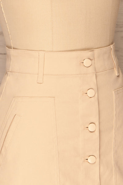 Alijo Beige Button-Up Mini Skirt with Pockets | La Petite Garçonne side close-up