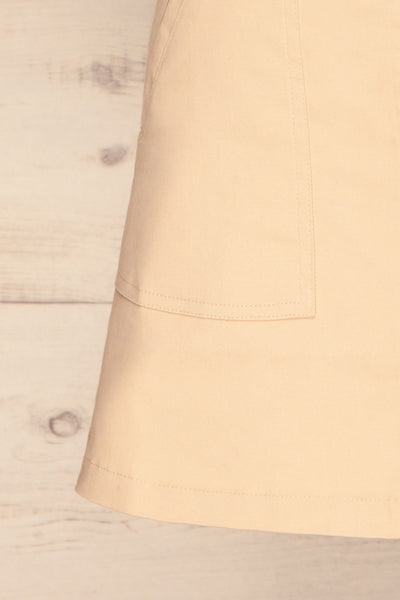 Alijo Beige Button-Up Mini Skirt with Pockets | La Petite Garçonne bottom close-up