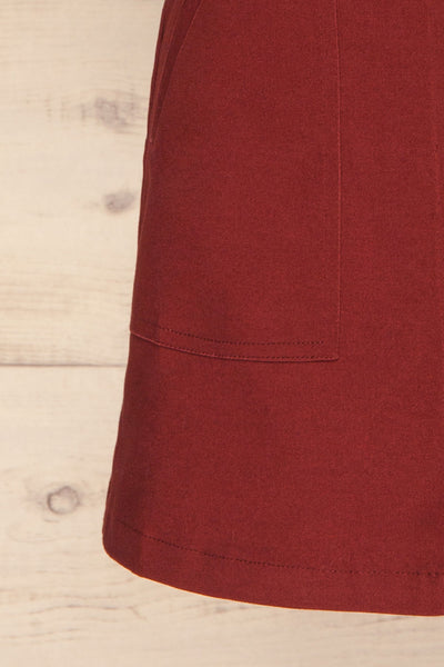 Alijo Burgundy Button-Up Mini Skirt with Pockets | La Petite Garçonne bottom close-up