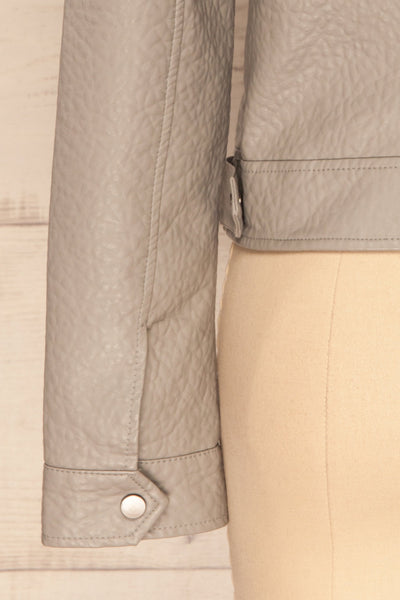 Almada Grey Faux Leather Motorcycle Jacket | La Petite Garçonne bottom close-up