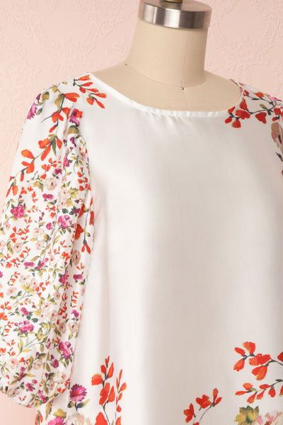 Angelica White Floral Puffy Sleeve Dress | Boutique 1861 side close up