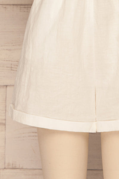 Arahal White Short Sleeved Linen Romper | La petite garçonne bottom close-up
