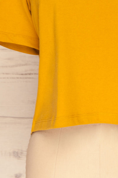 Arvika Wheat Yellow Cotton Cropped T-Shirt | La Petite Garçonne bottom close-up