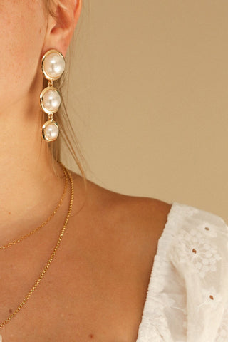 Averrhoa Golden & Pearl Pendant Earrings | La Petite Garçonne on model