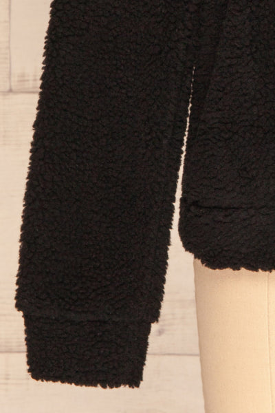 Banff Black & White Wooly Fleece Sweater | La Petite Garçonne bottom close-up