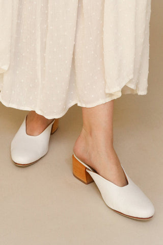Boicas Straw Beige Block Heel Mules on model close-up | La Petite Garçonne Chpt. 2