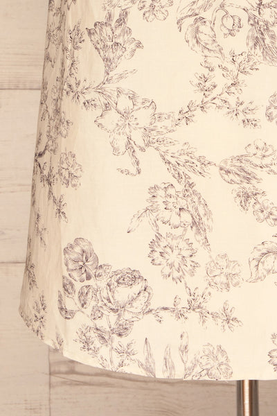 Cariyacu Off-White Floral Wrap Dress | La petite garçonne  bottom close-up