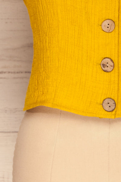 Catarama Sun Yellow Button-Up Crop Top | La Petite Garçonne bottom close-up