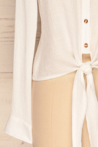 Cayambe Blanc White Crepe Button-Up Shirt | La Petite Garçonne bottom close-up
