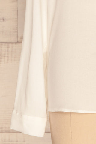 Clonmel Blanc White V-Neck Shirt sleeve close up | La Petite Garçonne