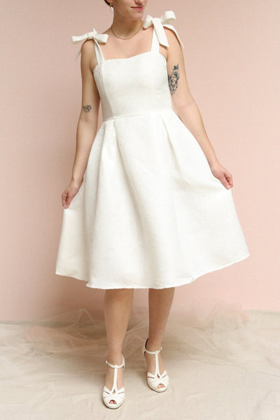 Cybill Ivory Brocade A-Line Cocktail Dress with Bows | Boutique 1861 on model
