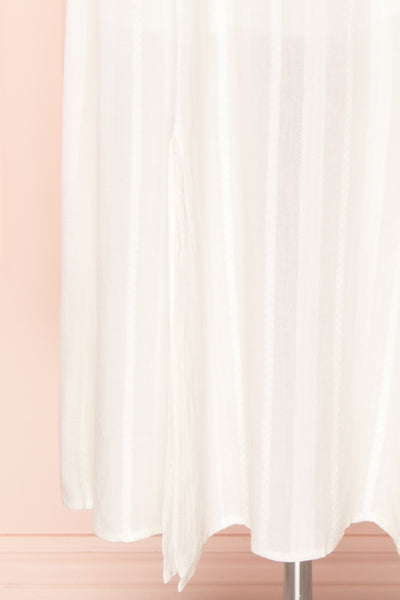 Czarne Daisy White Midi A-Line Dress with Puff Sleeves  | BOTTOM CLOSE UP | Boutique 1861
