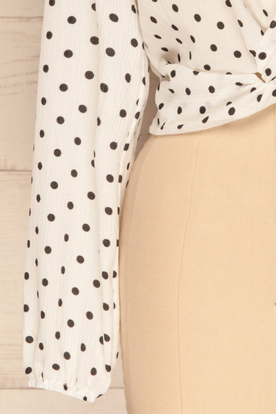 Czersk Blanc White Polkadot Long Sleeved Top | La Petite Garçonne sleeve close-up
