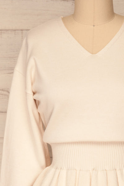 Daryna Beige Puff Sleeved Peplum Knit Top | La Petite Garçonne front close-up