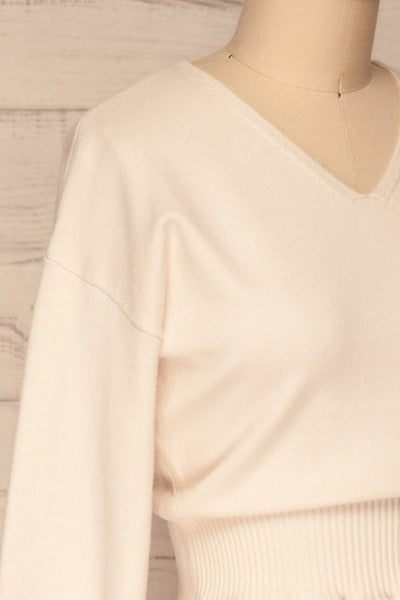 Daryna Beige Puff Sleeved Peplum Knit Top | La Petite Garçonne side close-up