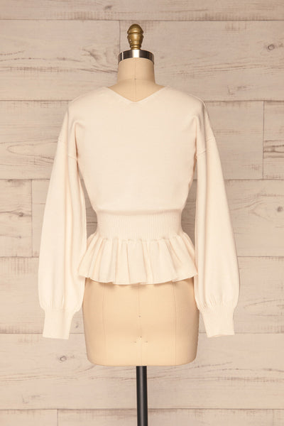 Daryna Beige Puff Sleeved Peplum Knit Top | La Petite Garçonne back view
